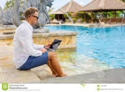 working by pool on laptop